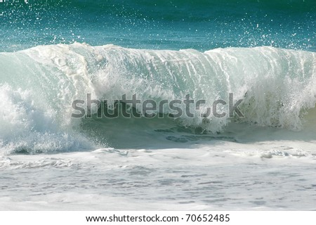 an atlantic wave breaks powerfully onto the shore - stock photo