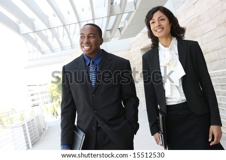 An attractive, african american business team meeting as a group