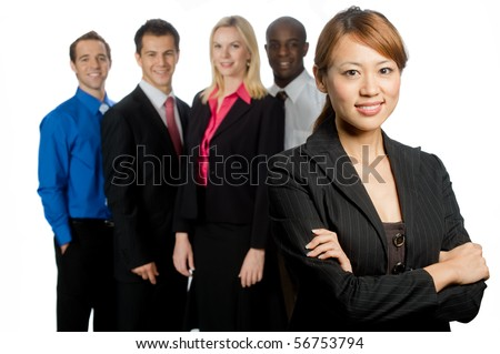 An attractive asian businesswoman and her team of professionals standing together on white background - stock photo