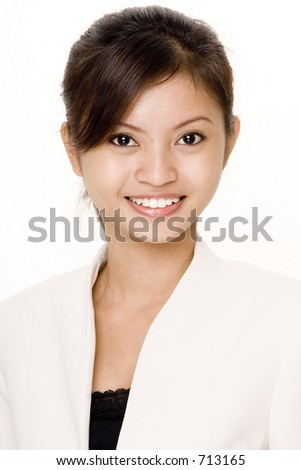 An attractive asian businesswoman in white on white