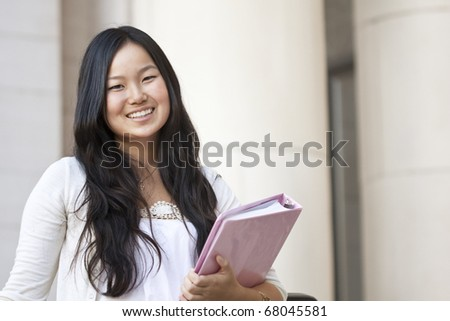 An attractive Asian college student portrait - stock photo