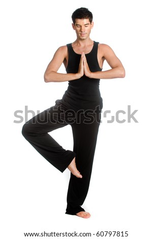 An attractive athletic man doing a yoga pose against white background - stock photo