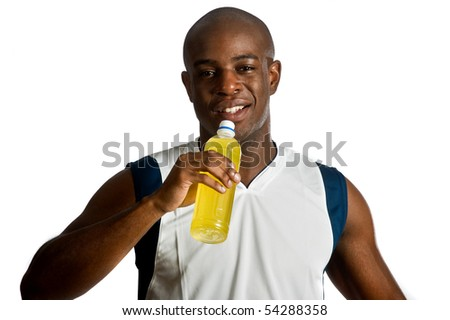 An attractive athletic man drinking an energy drink against white background - stock photo