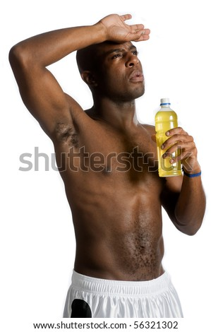 An attractive athletic man drinking an energy drink against white background
