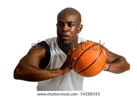 An attractive athletic man playing basketball against white background - stock photo