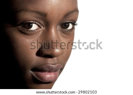 An attractive black girl making eye contact - stock photo