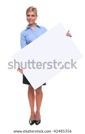 An attractive blond woman holding a blank sign looking towards camera, the board is a uniform color so you can make it larger if you wish to add your own image or message.