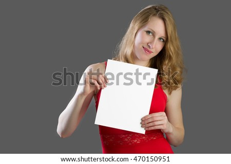 An attractive blonde woman with a white sign. Spot for your text