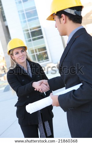 An attractive business construction team shaking hands on the building site