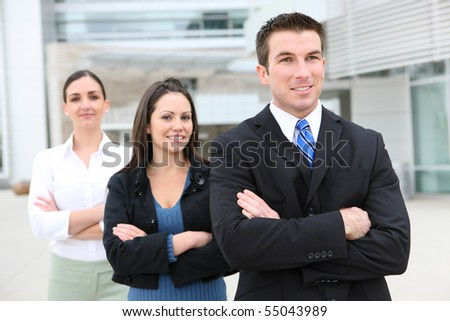 An attractive business man and woman team at office building
