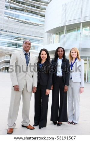 An attractive business man and woman team at office building diversity