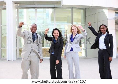 An attractive business man and woman team at office building diversity - stock photo