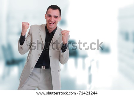 An attractive business man in a light business environment - stock photo