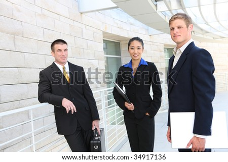 An attractive business team at the office (focus on woman)