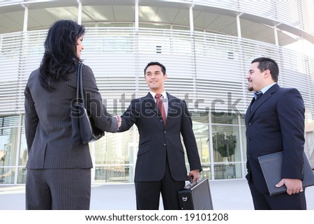 An attractive business team handshake at office building