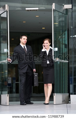 An attractive business team leaving the company after work - stock photo