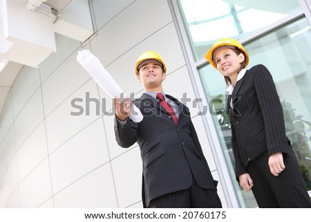 An attractive business team working construction on the building site - stock photo