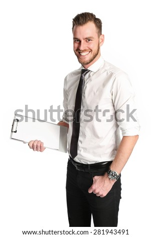 An attractive businessman wearing a wihte shirt and grey tie, standing against a white background holding a clipboard.  - stock photo