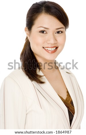 An attractive businesswoman in a cream suit on white background