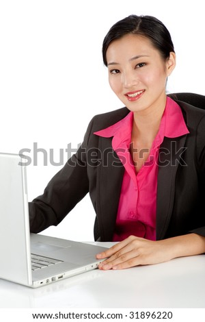 An attractive businesswoman on the computer at her desk