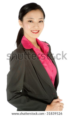 An attractive businesswoman posing in a studio - stock photo
