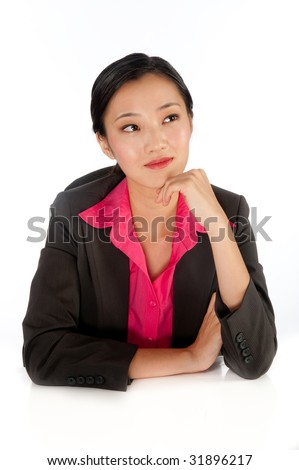 An attractive businesswoman sitting at her desk - stock photo