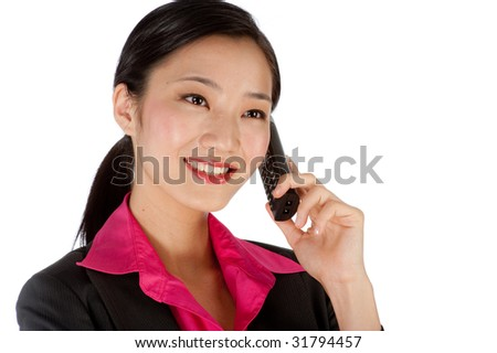An attractive businesswoman using a phone