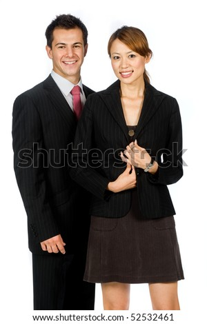 An attractive caucasian businessman with an asian businesswoman standing together on white background - stock photo