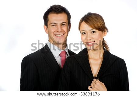 An attractive caucasian businessman with an asian businesswoman standing together on white background
