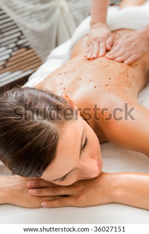 An attractive caucasian woman getting a scrub in a spa - stock photo