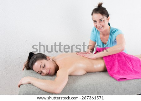 An attractive caucasian woman lying down on a massage table - stock photo