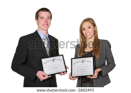 An attractive couple holding their certificates - stock photo