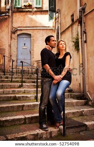 An attractive couple in a quaint european street - stock photo
