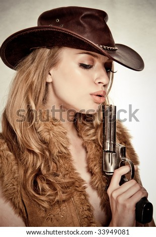 An attractive cowgirl - stock photo