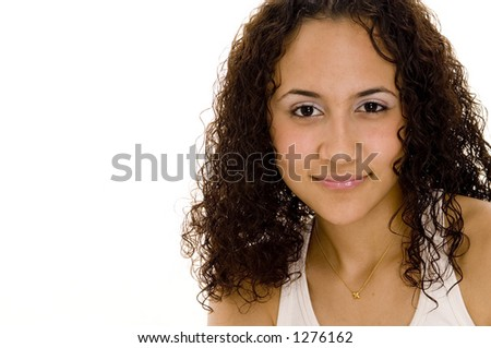 An attractive dark young woman - stock photo