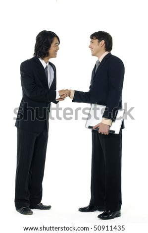An attractive, diverse business man team shaking hands