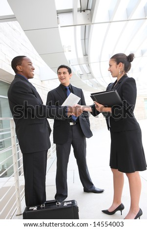 An attractive, diverse business team meeting as a group - stock photo