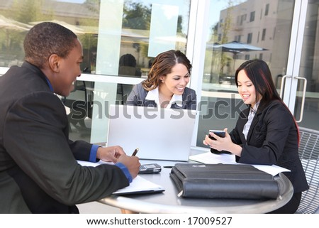 An attractive, diverse business team meeting as a group at office