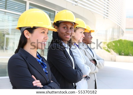 An attractive diverse man and woman architect team on construction site