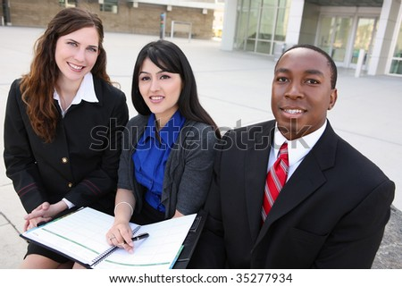 An attractive, diverse man and woman business team (Focus on Middle Woman)