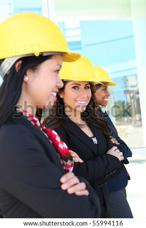 An attractive diverse woman architect team on construction site - stock photo