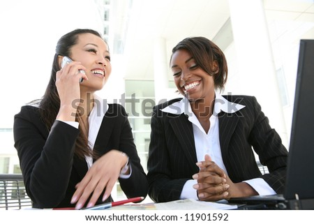 An attractive, diverse women business team at the office - stock photo