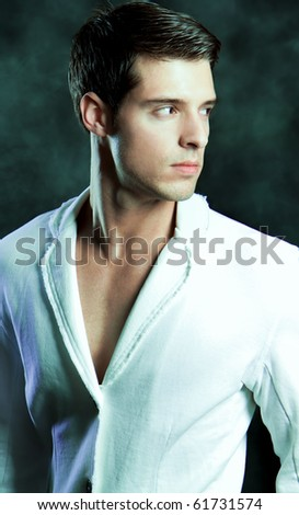 An attractive fashion man in a suit - stock photo