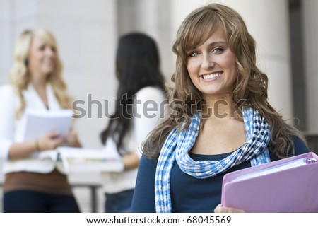 An attractive female college student portrait - stock photo