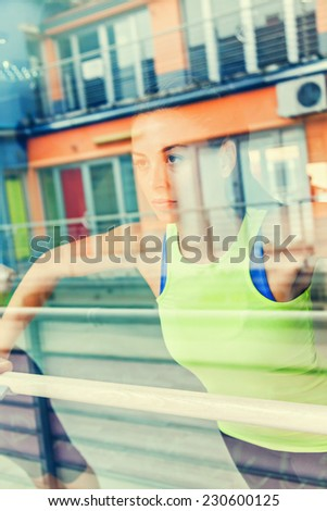 An Attractive Female Runner Stretching Before Workout - stock photo