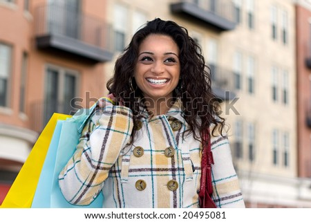 An attractive girl out shopping in the city. - stock photo