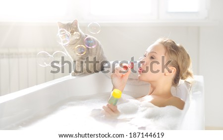 An Attractive girl relaxing in bath - stock photo