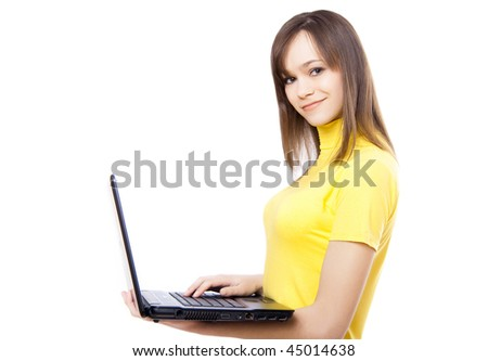 an attractive girl with a laptop - stock photo