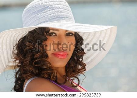 An attractive hispanic woman at the beach - stock photo