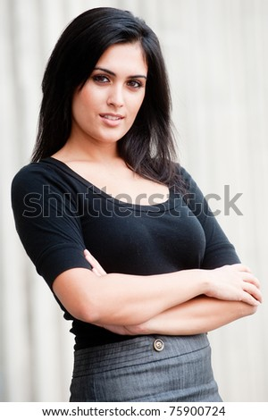An attractive Indian businesswoman standing outside - stock photo